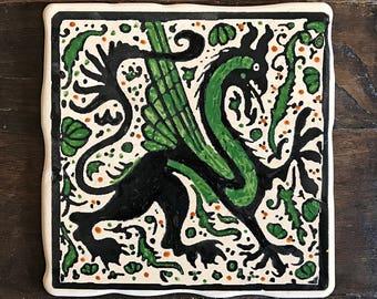 Medieval Dragon Hand painted ceramic tile Socarrat style.
