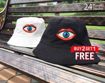 Eye in Lips Embroidered Bucket Hat by 24PlanetsStudio