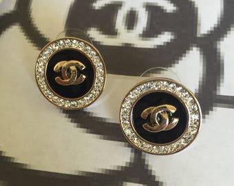 CC earrings.