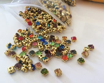 Set of 720 rhinestone Crystal set gold colored 5 mm