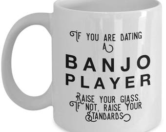 if you are dating a Banjo Player raise your glass. if not, raise your standards - Cool Valentine's Day Mug