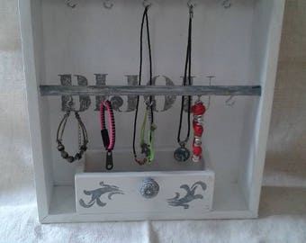 drawer into a weathered wall jewelry holder