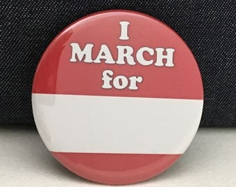 "2 1/4"" pinback button. You can create a custom message on this I MARCH FOR button."