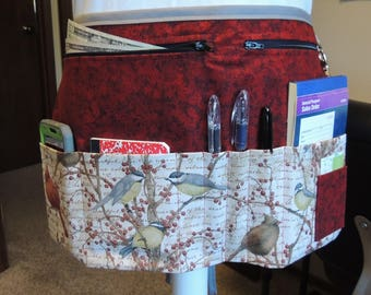 Multi-purpose vendor apron with lovely bird print and dark red background