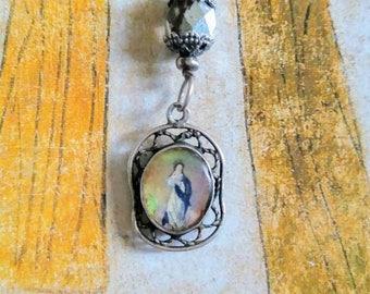 Antique handpainted opal Madonna pendant necklace .