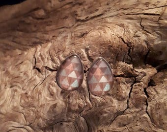 cabochon teardrop shaped 10 x 14 mm triangle on wooden base