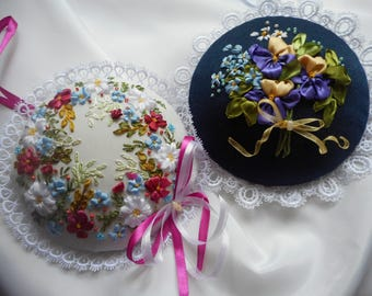 The pincushion with embroidery ribbons Three roses