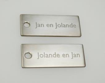 Custom order for Jan. Bestelling voor Jan. Paar titanium sleutelhangers.