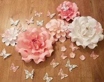Pink and white paper flowers with butterflies