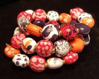 Kazuri Beads handmade Fair Trade Ceramic wrap around Bracelet from Kenya. Red orange black white beads gold fixings fashion accessessory