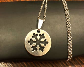 Snowflake Cut Out Necklace on Stainless Steel 18 inch chain