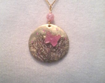 Gold print pendant branches fluorescent pink butterfly