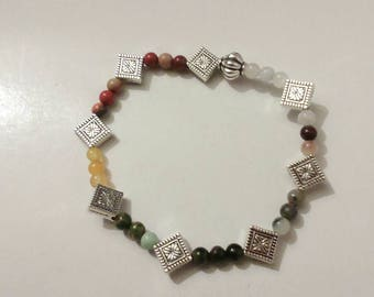 Seven Chakras Bracelet made with semi precious stones and silver plated accents.