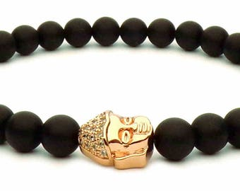 The bracelet rose gold Buddha