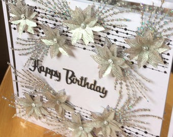 hand-made birthday card in black, white and silver with glittering foliage