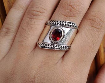 925 Sterling silver ring with garnet stone.