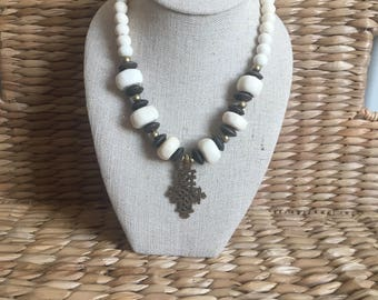 Bone and wood necklace with brass Coptic cross pendant
