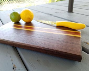 Walnut, purpleheart and yellowheart cutting board