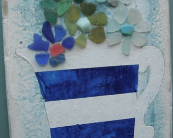Sea glass flowers in a hand painted Cornish jug picture.