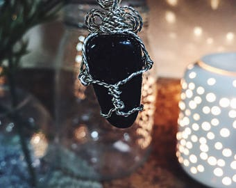 Black tourmaline twisted Silver spiral wire wrap.