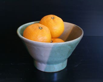 Grey, green and white serving bowl with raw unglazed areas