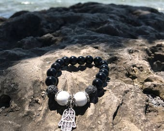 Black onyx beaded bracelet with hamsa charm