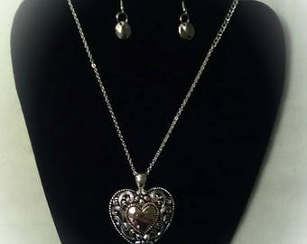 This one of a kind set includes earrings and necklace