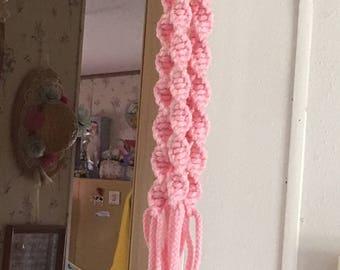 Pastel pink macrame plant hanger