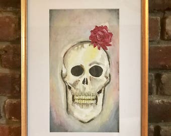 front facing skull and flower in mixed media