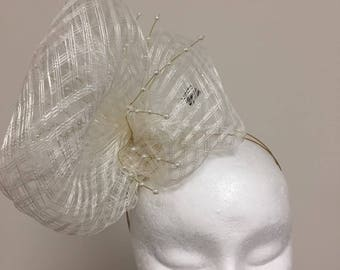 Stunning cream net fascinator with beautiful bead detail, perfect for weddings or any special occassions!