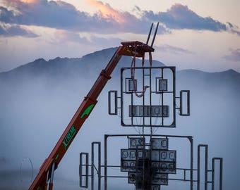 Robot Heart on a crane at sunrise Burning Man 2016