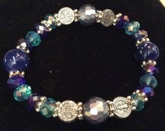 Blue stretchy glass beaded cross bracelet
