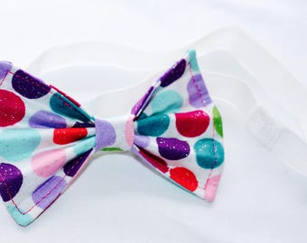 Multi-colored polka dot hair bow with matching headband.