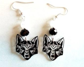 Foxes tattoo effect earrings.