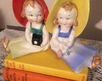 Unique and authentic 1930's figurine bookends.