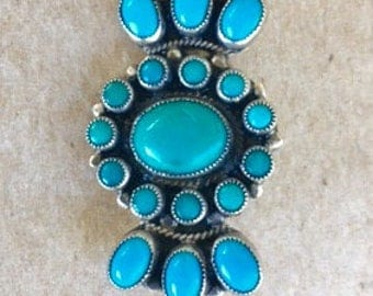 Native American turquoise and sterling silver pin.  Made by Leo Feeney.