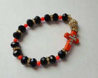 Orange and black beaded cross bracelet