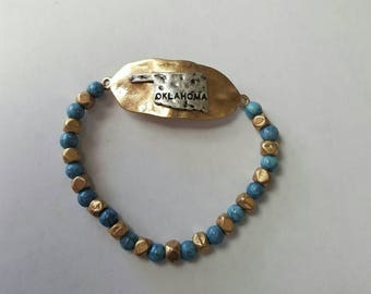 Teal and gold Oklahoma bracelet