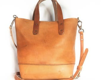 Hand-stitched leather crossbody tote with inside pocket