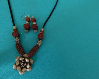 Rose necklace with deep red accent beads, with matching earrings