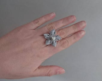 Gray fabric with white polka dots adjustable flower ring