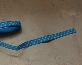 Ribbon 10mm white stars on blue background