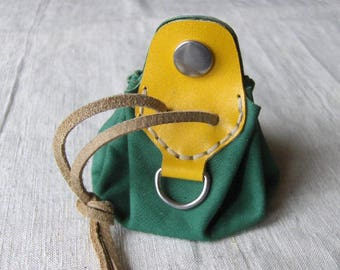 Coin purse is yellow-green leather