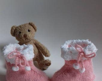 1 pair of pink and white slippers for baby