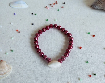 Shell bracelet with dark Pink Pearl