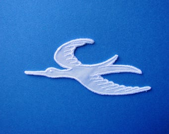 Applique badge sewing 14 x 6,5 cm, white bird.