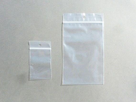 50 sachets 8x12 cm plastique grip zip transparent trou 40. Black Bedroom Furniture Sets. Home Design Ideas