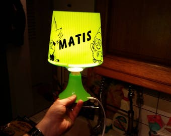 "Green lamp with a ""Minion"" in vinyl with a name on the foot"