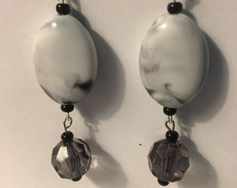 Dangle black and white marble earrings.