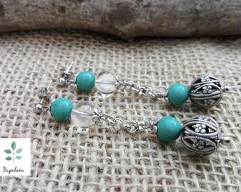 Turquoise earrings and rock crystal.